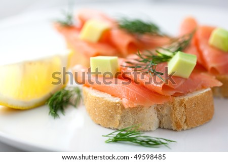 Canapes with salmon and avocado