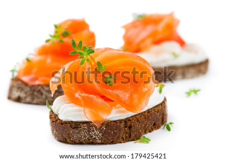 Canapes with salmon isolated on white background - stock photo