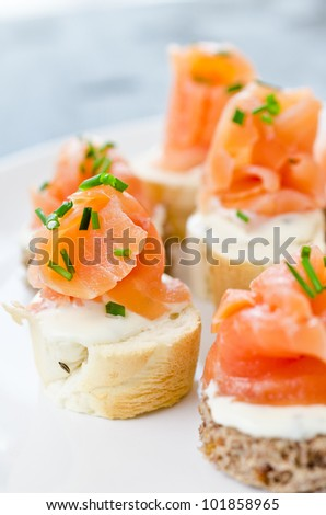 Round crackers cream dill salmon plate stock photo for Cream cheese canape