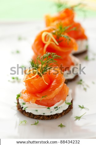 Canapes with smoked salmon and cream cheese - stock photo