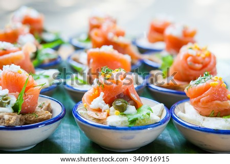 canapes with smoked salmon set for wedding party. - stock photo