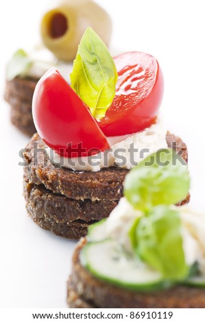 Canapes with tomato and feta - stock photo
