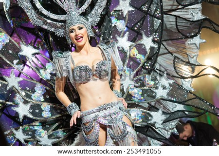 CANARY ISLAND, SPAIN - FEBRUARY 13, 2015: Alba Sanchez Diaz onstage with costume from designer Mari Patron during city of Las Palmas carnival One Thousand and One Nights Queens Gala show. - stock photo