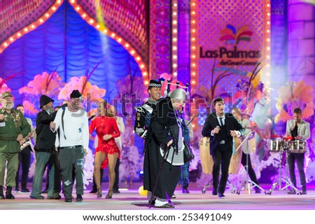 CANARY ISLAND, SPAIN - FEBRUARY 13, 2015: Armonia Show and unidentified people with costumes performing onstage during city of Las Palmas carnival One Thousand and One Nights Queens Gala show. - stock photo