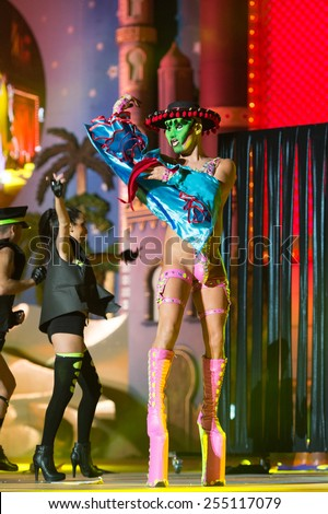 CANARY ISLAND, SPAIN - FEBRUARY 20, 2015: Drag Gio with Mexican costume from Raico Santana and unidentified assistants as policemen performing onstage during Las Palmas carnival Drag Queen Gala. - stock photo