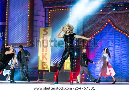 CANARY ISLAND, SPAIN - FEBRUARY 20, 2015: Drag Ikaro (m) as Olivia Newton John from the movie Grease and unidentified assistants with Grease costumes performing onstage during Drag Queen Gala. - stock photo