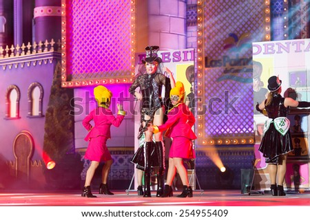 CANARY ISLAND, SPAIN - FEBRUARY 20, 2015: Drag Ohfelia with costume from Carlos Suarez Pestana(m) and unidentified women onstage during city of Las Palmas carnival Drag Queen - stock photo