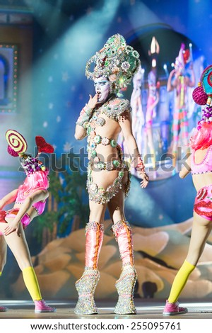 CANARY ISLAND, SPAIN - FEBRUARY 20, 2015: Drag Vulcano with costume from designer Isidro Javier Perez Mateo and unidentified assistants performing onstage during Las Palmas carnival Drag Queen Gala.
