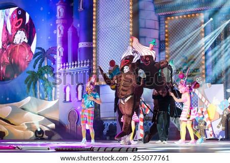 CANARY ISLAND, SPAIN - FEBRUARY 20, 2015: Drag Vulcano with gingerbread cookie costume from Isidro Javier Perez Mateo and unidentified assistants onstage during Las Palmas carnival Drag Queen Gala. - stock photo
