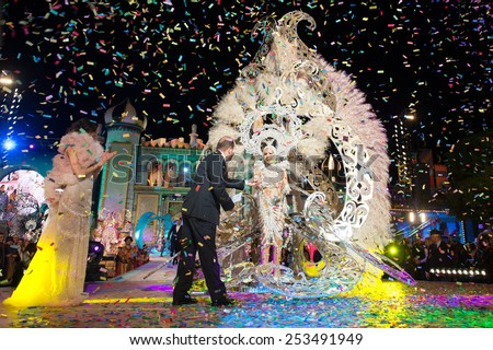 CANARY ISLAND, SPAIN - FEBRUARY 13, 2015: 1st prize to Aranzazu Estevez is presented by Juan Jose Cardona (m) and unidentified people during the carnival One Thousand and One Nights Queens Gala show.