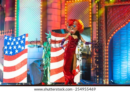CANARY ISLAND, SPAIN - FEBRUARY 20, 2015: Unidentified assistant with comic costume performing onstage during city of Las Palmas carnival Drag Queen Gala. - stock photo