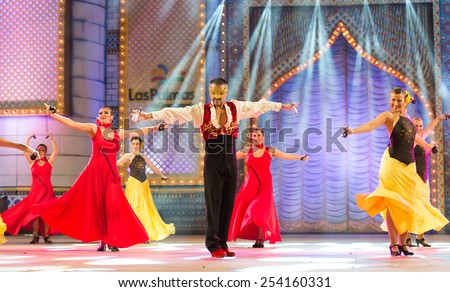 CANARY ISLAND, SPAIN - FEBRUARY 17, 2015: Unidentified dancers from Ballet Espanol de Javier del Real dancing tango onstage during city of Las Palmas carnival Body Painting Contest. - stock photo