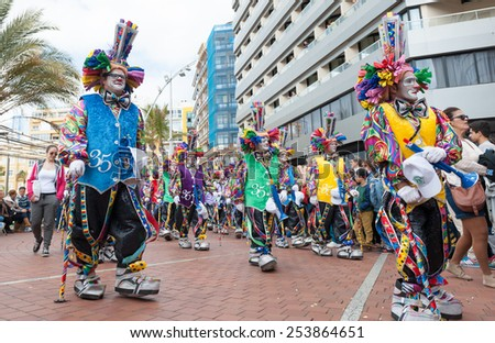 CANARY ISLAND, SPAIN - FEBRUARY 17, 2015: Unidentified people with  clown costumes from Murga Los Chancletas walking to samba rhythms in the streets during city of Las Palmas carnival in the sun.