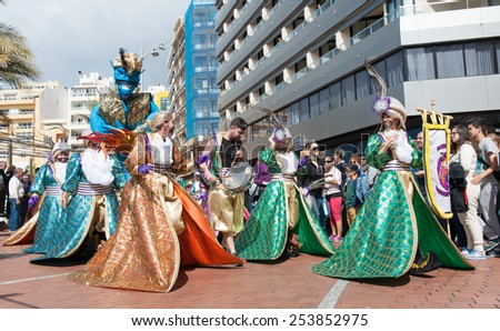 CANARY ISLAND, SPAIN - FEBRUARY 17, 2015: Unidentified women with costumes from Murga Las Traviesas walking to samba rhythms in the streets during city of Las Palmas carnival in the sun. - stock photo
