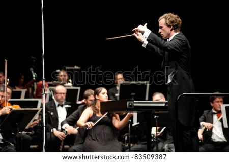 CANARY ISLANDS – AUGUST: 03: Conductor Michael Zlabinger from US, onstage with Otto Edelmann Socity and Sinfonica de Las Palmas, during Festival of Music August 03, 2011 in Canary Islands, Spain - stock photo