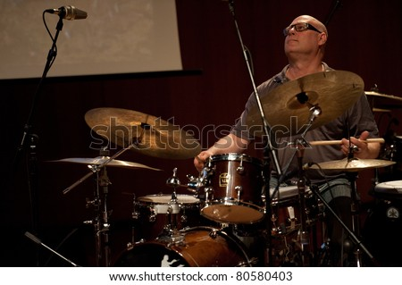 CANARY ISLANDS - JULY 6: Christian Scheuber on drums from Three in the Red Circle from Germany, performing onstage during Festival Canarias Jazz & mas July 6, 2011 in Las Palmas, Canary Islands, Spain