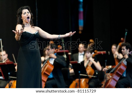 CANARY ISLANDS - JULY 16: Mezzo-soprano Alessandra Volpe from Italy, singing II Barbiere di Siviglia from Rossini, onstage during Festival of Music July 16, 2011 in Las Palmas, Canary Islands, Spain - stock photo