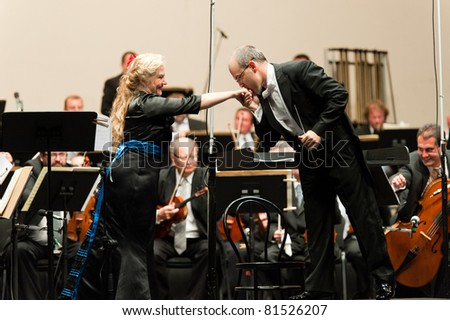CANARY ISLANDS - JULY 23: Soprano Ana Carolina Diz from Argentina and Conductor David Hernando Rico from Spain performing onstage, during Festival of Music July 23, 2011 in Canary Islands, Spain - stock photo