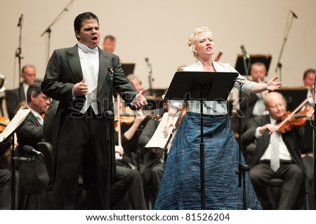 CANARY ISLANDS - JULY 23: Soprano Ana Carolina Diz from Argentina, and Tenor Francisco Corujo from Spain performing onstage, during Festival of Music July 23, 2011 in Las Palmas, Canary Islands,Spain - stock photo