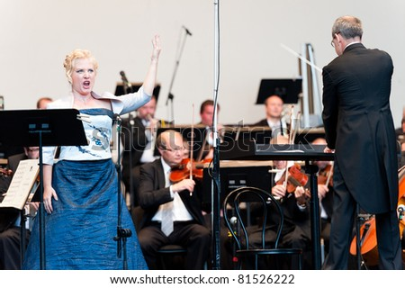 CANARY ISLANDS - JULY 23: Soprano Ana Carolina Diz from Argentina, performing onstage with Bratislava Symphony Orchestra from Slovakia, during Festival of Music July 23, 2011 in Canary Islands, Spain - stock photo