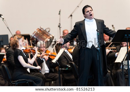 CANARY ISLANDS - JULY 23: Tenor Francisco Corujo from Spain, performing onstage with Bratislava Symphony Orchestra from Slovakia, during Festival of Music July 23, 2011 in Canary Islands, Spain - stock photo