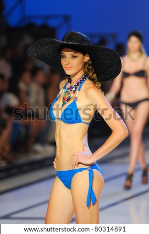 CANARY ISLANDS -JUNE 18:Aida Artiles walks the runway in the Vitamina C and Laja Picon collection during Moda Calida in Maspalomas June 18, 2011 in Canary Islands, Spain - stock photo