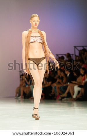 CANARY ISLANDS -JUNE 23: An unidentified model walks the runway in the Alida Dominguez (AD) collection during Gran Canaria Moda Calida swimwear fashion show on June 23, 2012 in Canary Islands, Spain - stock photo