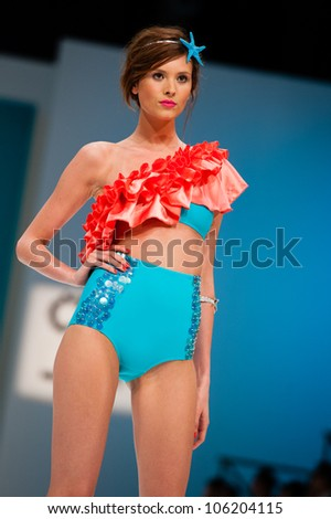 CANARY ISLANDS -JUNE 22: An unidentified model walks the runway in the Calima collection during Gran Canaria Moda Calida swimwear fashion show on June 22, 2012 in Canary Islands, Spain - stock photo