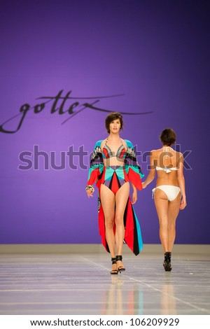 CANARY ISLANDS -JUNE 22: Unidentified models walks the runway in the Gottex collection during Gran Canaria Moda Calida swimwear fashion show on June 22, 2012 in Canary Islands, Spain - stock photo