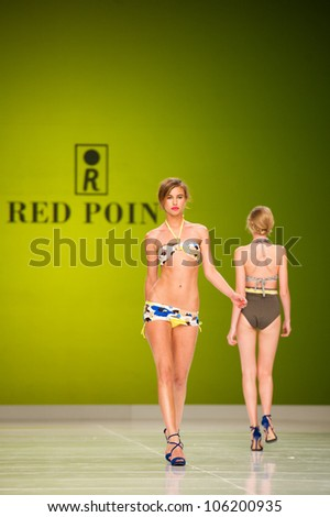 CANARY ISLANDS -JUNE 22: Unidentified models walks the runway in the Red Point collection during Gran Canaria Moda Calida swimwear fashion show on June 22, 2012 in Canary Islands, Spain - stock photo