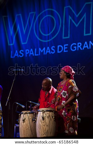 CANARY ISLANDS - NOVEMBER 11: Creole Choir of Cuba, musical treasures from Haiti, Dominica and Cuba,  performing onstage during Womad in Las Palmas November 11, 2010 in Canary Islands, Spain - stock photo