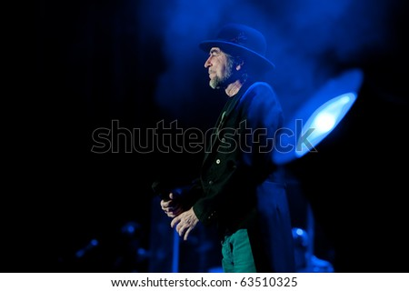 CANARY ISLANDS - OCTOBER 21: Singer, songwriter and poet Joaquin Sabina from Spain performing at stage for 12.000 people at El Estadio de Gran Canaria October 21, 2010 in Canary Islands
