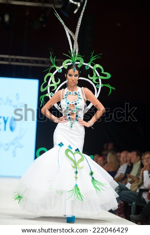 CANARY ISLANDS -27 SEPTEMBER: Unidentified model on the catwalk wearing carnival costume from designer Beyo during Carnival Fashion World in Las Palmas September 27, 2014 in Canary Islands, Spain - stock photo