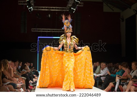 CANARY ISLANDS - 27 SEPTEMBER: Unidentified model on the catwalk wearing carnival costume from Juan Penate during Carnival Fashion World in Las Palmas September 27, 2014 in Canary Islands, Spain - stock photo