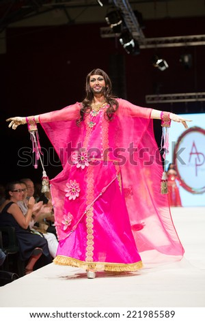 CANARY ISLANDS - 26 SEPTEMBER: Unidentified model on the catwalk wearing costume from designer Alberto Perez during Carnival Fashion World in Las Palmas September 26, 2014 in Canary Islands, Spain - stock photo