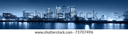 Canary Wharf at dusk, Famous skyscrapers of London's financial district at twilight. - stock photo