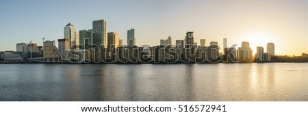 Canary Wharf business district in London at sunrise