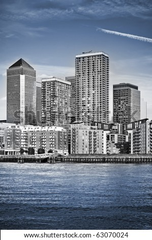 Canary Wharf, Famous skyscrapers of London's financial district. This view includes: Credit Suisse, Morgan Stanley, HSBC Group Head Office, Canary Wharf Tower, Citigroup Centre and apartment houses - stock photo