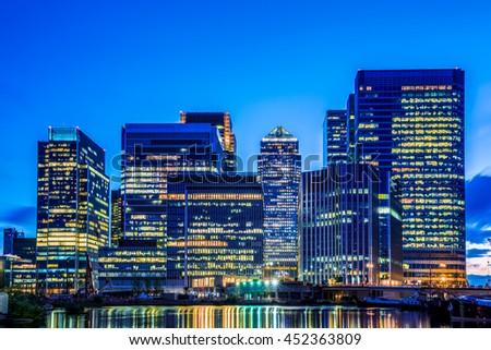 Canary Wharf, financial hub in London at night - stock photo