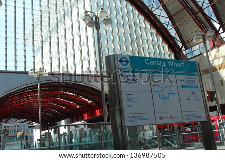 CANARY WHARF, LONDON-JULY 16: Canary Wharf Dockland Light Railway (DLR) station in Canary Wharf on July 16, 2006. The station managed by DLR handles around 16 million commuters annually.