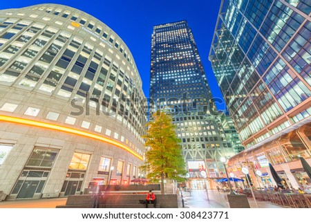CANARY WHARF, LONDON - JUNE 29, 2015: Modern buildings at night. Canary Wharf is the business city district of London. - stock photo