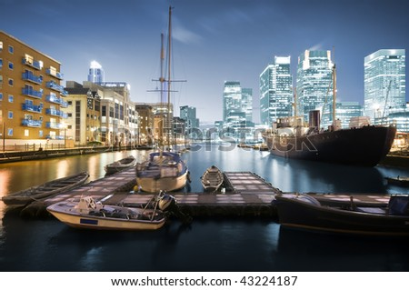 Canary Wharf Skyline at Twilight Skyline of Canary Wharf view from West India Millwall Docks. This view includes: Citigroup Centre,Morgan Stanley and Luxury Riverside Apartments. - stock photo