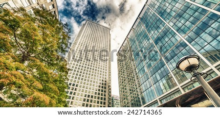Canary Wharf skyline, office buildings, street view - London. - stock photo