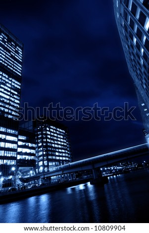 Canary Wharf the business circle of London with skyscrapers at night - stock photo