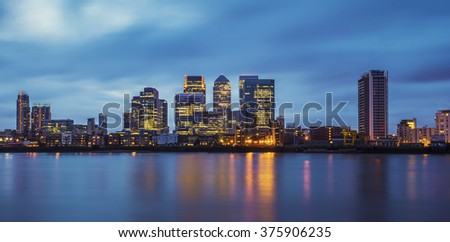 Canary Wharf, the famous business district and skyscrapers of London at blue hour - London, UK - stock photo