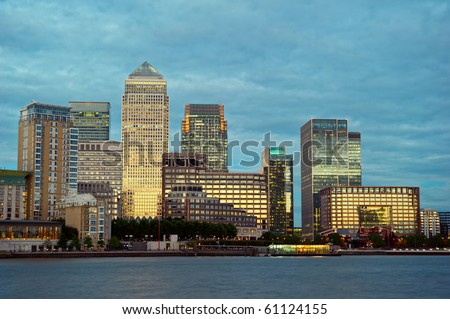 Canary Wharf, the other financial business district, Isle of Dogs, London, England, UK, Europe, at dusk - stock photo