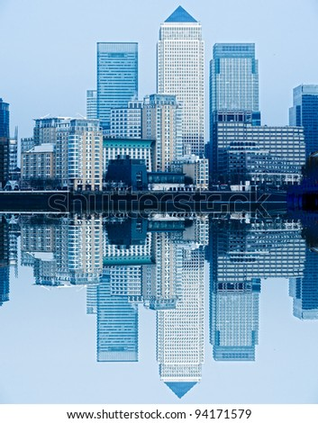 Canary Wharf, with waves reflection, London, UK - stock photo