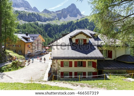 Canazei, Italy - August 7, 2016: Alpine hut Refugio Contrin in in the Dolomites Mountains.