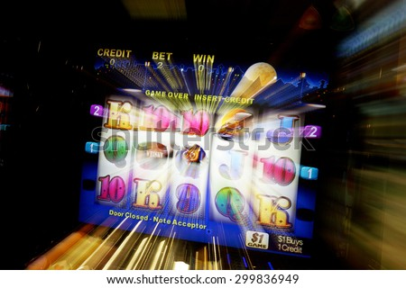 CANBERRA, AUSTRALIA, August 30, 2006: Abstract image of Poker machine, or gaming machine. Australia has over 180,000 machines, 2.1 percent of the world total. - stock photo