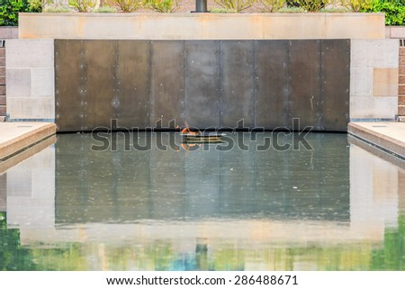 CANBERRA, AUSTRALIA - MAR 25: The flame at the Australian War Memorial on Mar 25, 2015 in Canberra. It's Australia's national memorial to the members of its armed forces who have died in the wars. - stock photo